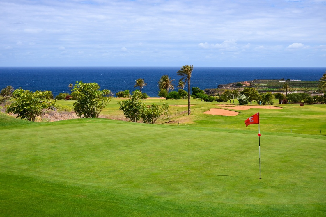 Flag on green grass in golf course of Buenavista del Norte, Tenerife, Canary Islands