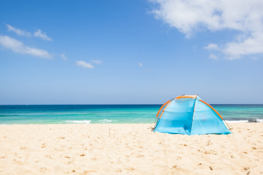 'camping with a tent at a lonesome beach with a turquoise sea and blue sky in the background, Fuerteventura, Canary Islands, Spain, Europe' - Isole Canarie